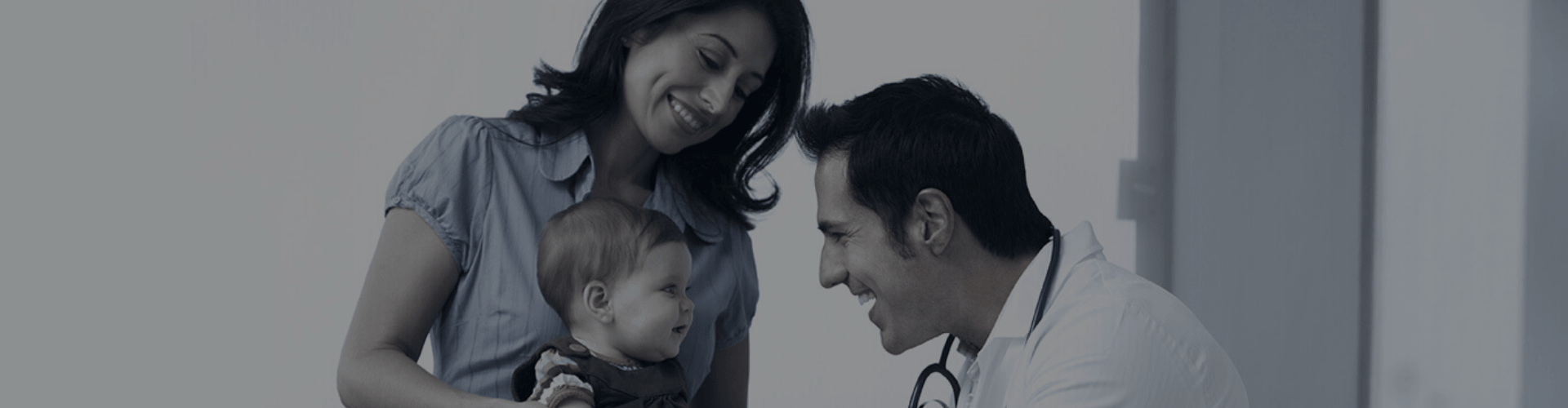 The doctor is treating the child in front of the child's mother.