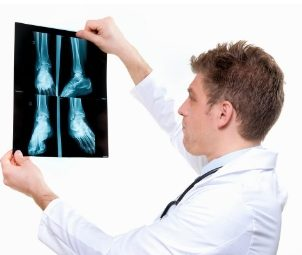 A doctor looking the X-Ray report